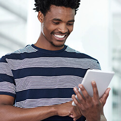 Young man on an iPad